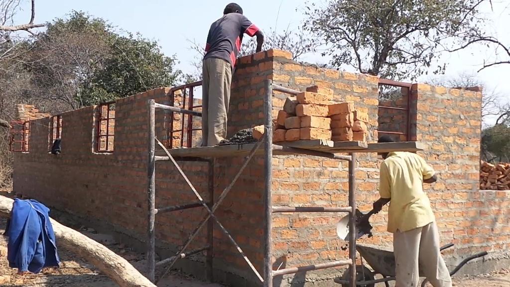 Building the teacher's houses.