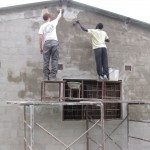Rough plastering the outside of the building